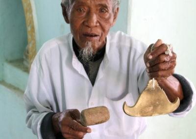 A man holding a glass
