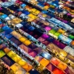 A row of colorful food stalls