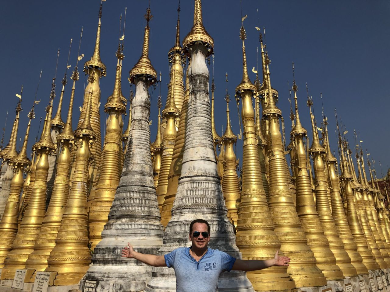 A person standing in front of Stupas